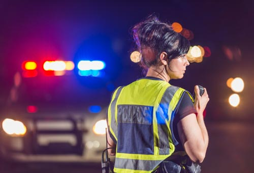 Female police officer at night