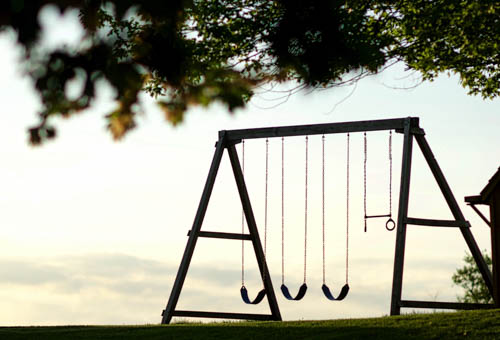 Swingset at sunset, silhouette
