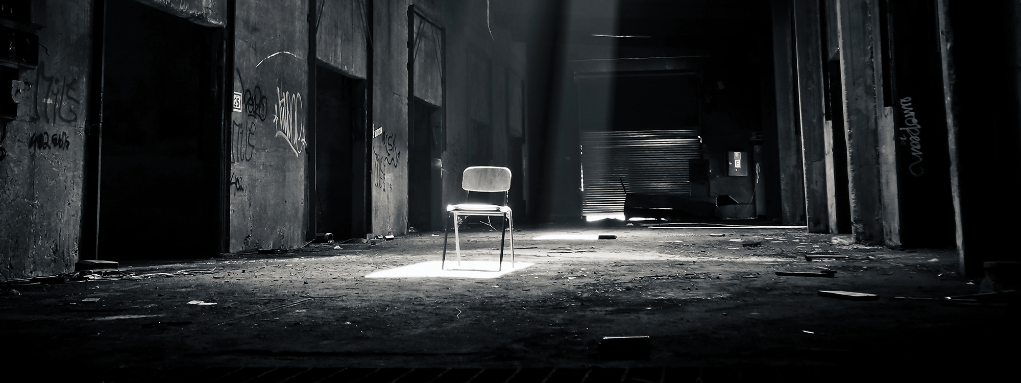empty chair in an empty warehouse