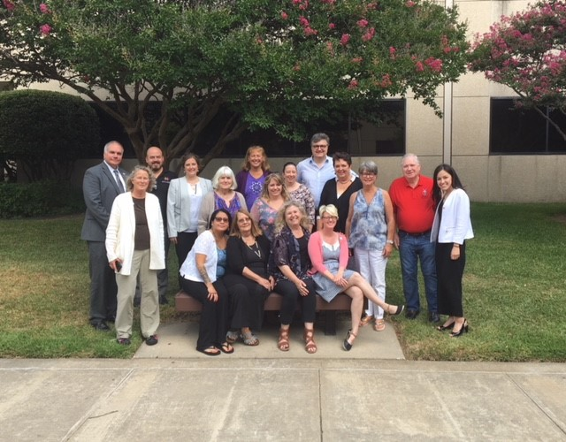 2018 Family Roundtable Participants gathered for an outdoor group photo.