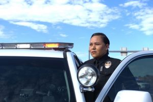 Native American Female Police Officer Exiting her Police Car