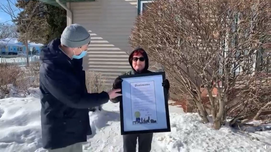 """Minneapolis Mayor Jacob Frey presents Barbara Gusse with the """"Barbara Gusse Day"""" proclamation"""